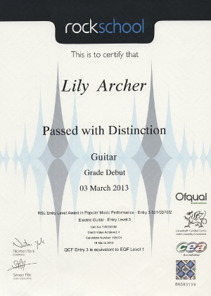 Guitar student, Lily's exam certificate- pass with distinction.